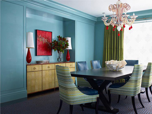 blue green red funky modern living room with white and red chandelier