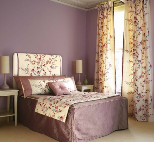 purple romantic bedroom with rose fabric headboard