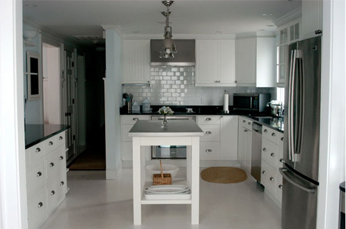 coastal beachy kitchen white cabinets wooden island
