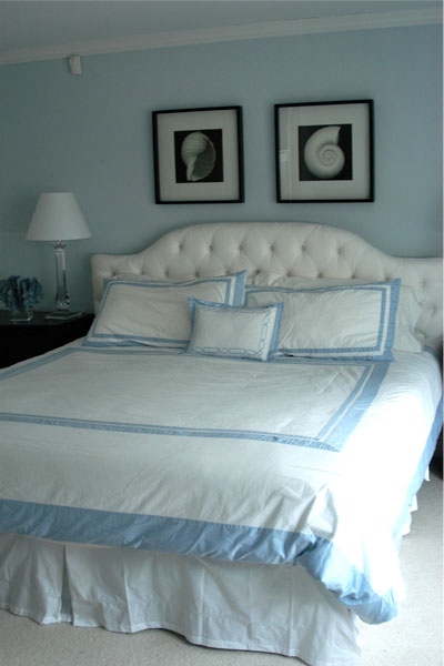 baby blue and white coastal bedroom with white headboard